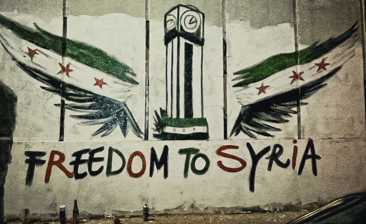 """Freedom to Syria"", by Freedom House, licensed under CC BY 2.0 (edited)."