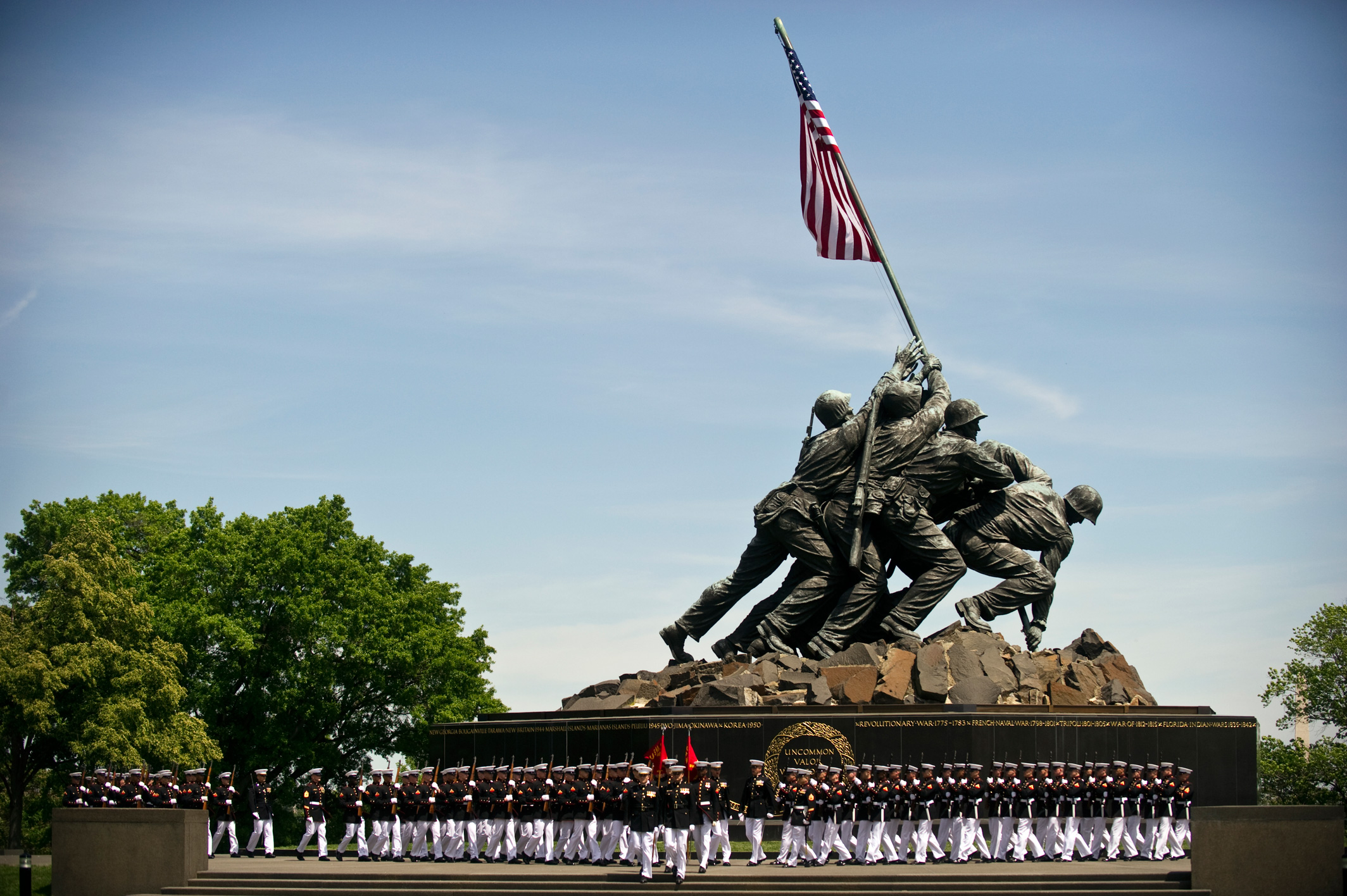 US_Navy_110510-N-UH963-066_Marines_march_past_the_Marine_Corps_War_Memorial_during_a_Navy_Cross_medal_award_ceremony_honoring_Gunnery_Sgt_edit