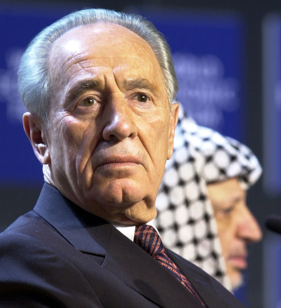 DAVOS/SWITZERLAND,28JAN01 - Minister of Regional Cooperation of Israel Shimon Peres (L) and President of the Palestinian Authority Yasser Arafat (R) attend a session entitled 'From Peacemaking to Peacebuilding' at the Annual Meeting 2001 of the World Economic Forum in Davos, January 28, 2001. Byline: swiss-image.ch/Photo by Remy Steinegger NO RESALES, NO ARCHIVES